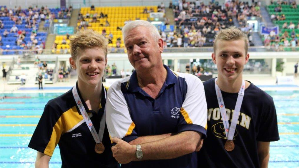 MEDALISTS ETHAN AND JARROD WITH COACH BILL